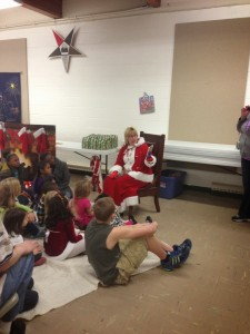 Mrs. Claus reading to the kids.